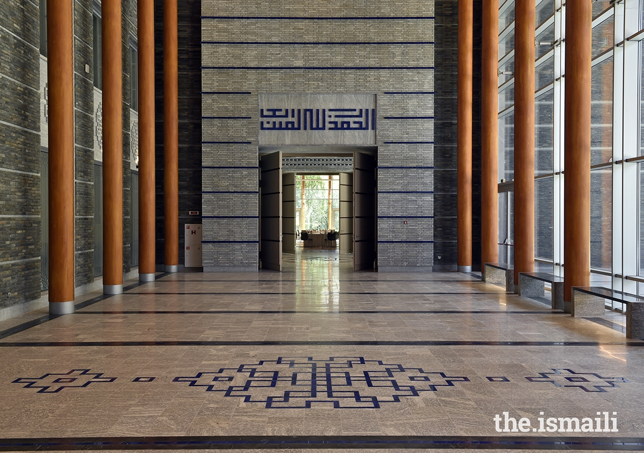 "The social hall portal entrance at the Ismaili Jamatkhana and Centre, Khorog. The geometric Kufic script above the portal reads: ""Al-hamdu lillahi rabil 'alamin."""