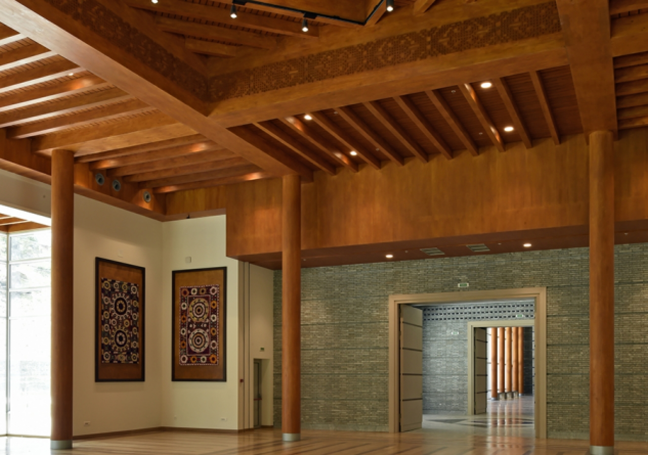 The social hall of the Ismaili Jamatkhana and Centre, with a wooden floor, reflecting the pattern of its traditional Pamiri roof.