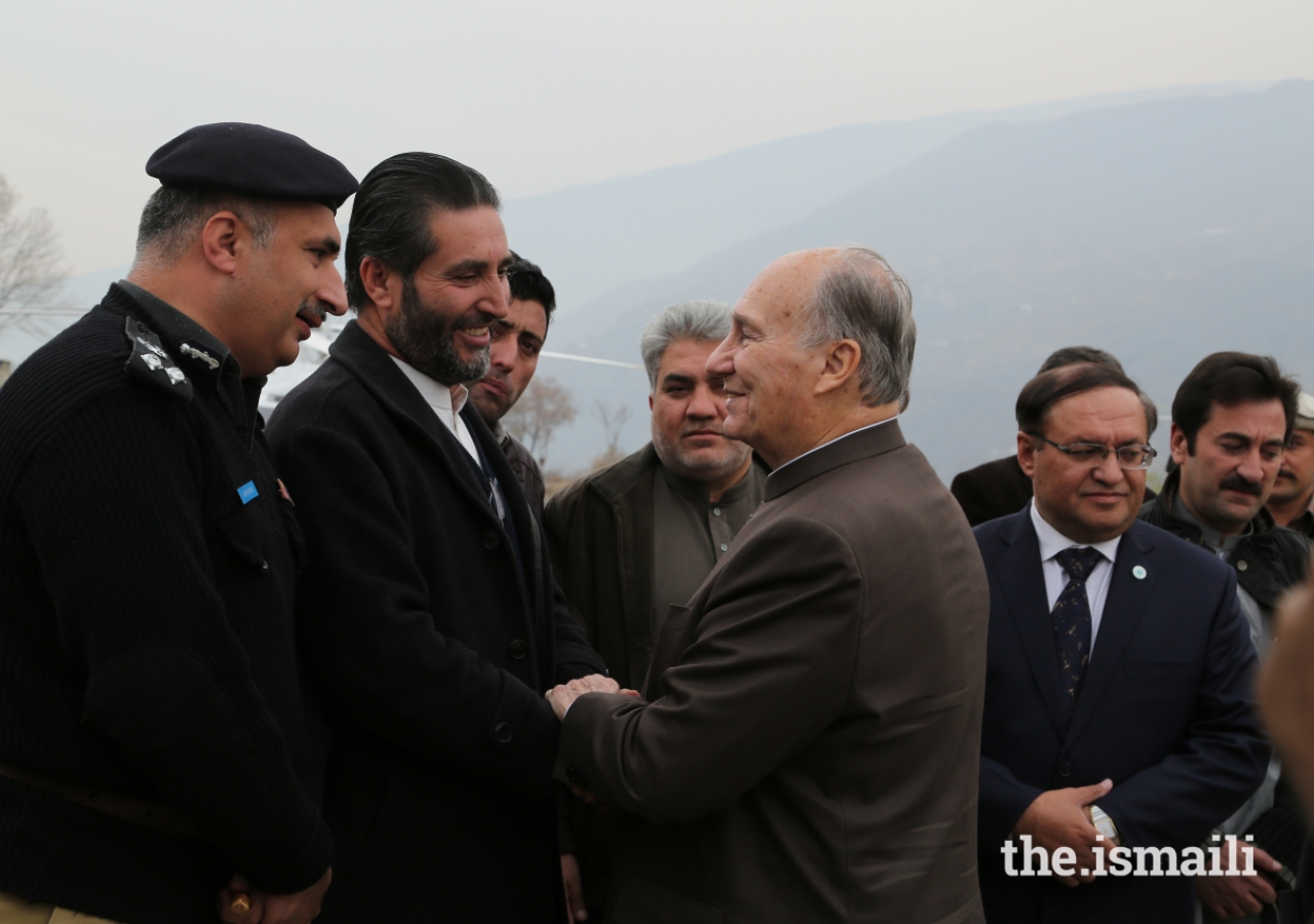 Mawlana Hazar Imam is greeted by Magfirat Shah, District Nazim, Chitral upon his departure from the Chitral Town Airport