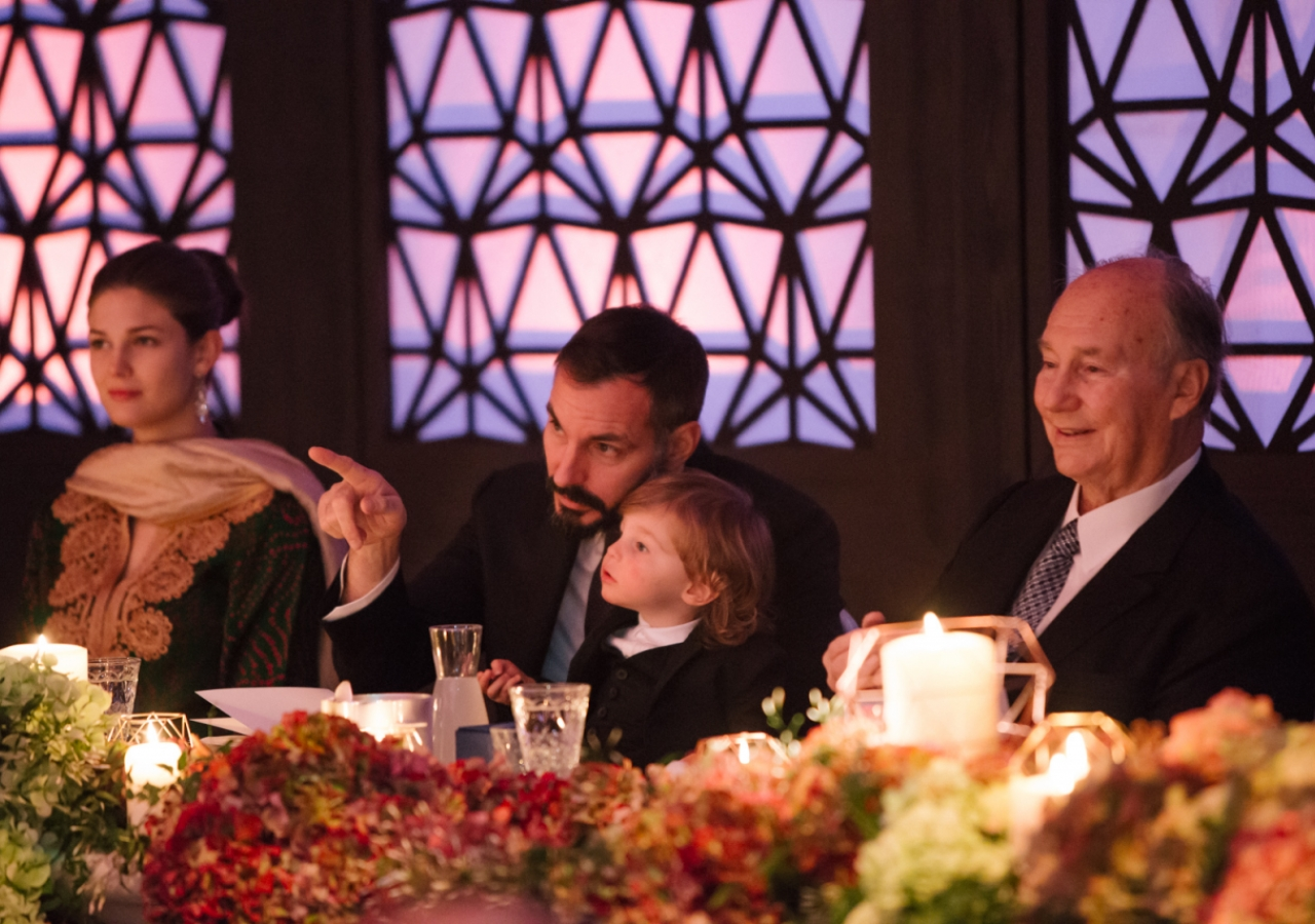 Prince Rahim points out an element of the decor to the young Prince Irfan while Princess Salwa and Mawlana Hazar Imam look on. Photo: Farhez Rayani