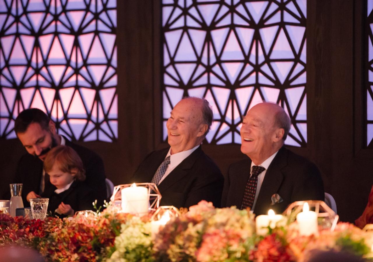 Mawlana Hazar Imam and Prince Amyn share in laughter during Chairman Eboo's address. Photo: Farhez Rayani