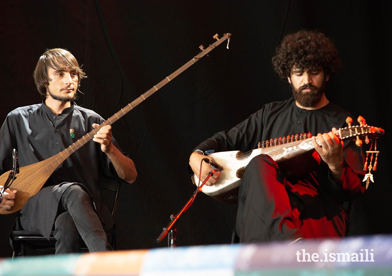 Musicians perform on the dudar and rubab.
