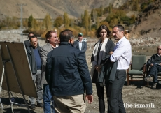 Prince Rahim and Princess Salwa receive a briefing from community leaders and management of the Aga Khan Agency for Habitat (AKAH) on community-based mitigation work undertaken at a disaster-affected site in the village of Darkut, Silgan Valley, Ghizer District, in Gilgit-Baltistan. The village of Darkut is vulnerable to natural hazards including flash floods and rock falls which can destroy houses, farmland and other infrastructure.