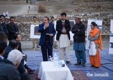 Prince Rahim and Princess Salwa receive a briefing from community leaders and management of the Aga Khan Agency for Habitat (AKAH) in the village of Bilhanz located in Immit, Ishkoman Valley, Ghizer District in Gilgit-Baltistan. In July 2018, unusually warm weather precipitated intensified melting of snow and glaciers which resulted in a large glacial lake outburst flood (GLOF) which submerged farmland and destroyed houses in Badswat and Bilhanz villages.