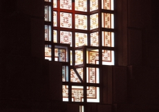The opalescent cast-glass windows in the Prayer Hall are decorated with stained geometric patterns.