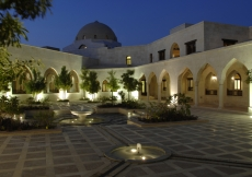 Fountains of arboreal calm: the Takhtabosh Courtyard at dusk.