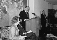 Mawlana Hazar Imam addresses the audience at the Opening Ceremony of the Ismaili Centre, London, as Prime Minister Margaret Thatcher and Ismaili Council President Anil Ishani look on.