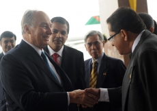 Mawlana Hazar Imam is greeted by Alijah Jamal Surani, Vice-President of the Ismaili Council for the Far East.