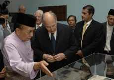 Mawlana Hazar Imam and Minister Dato Seri Utama Dr Rais Yatim discuss an artefact at the exhibition, as Rai Inayat Bana, President of the Ismaili Council for the Far East, looks on.