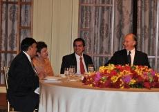 Mawlana Hazar Imam shares a light moment with President Inayat Bana, Vice-President Banoo Shanaz Mawji and Shafik Sachedina during the Far East Instititional Dinner.