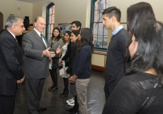 Mawlana Hazar Imam stops to speak with a group of Ismaili students currently studying at Brown University.