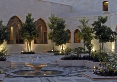 The main courtyard features an intricate geometric arrangement of channels that use gravity to carry water from a central fountain. The marble patterns and flower beds draw upon various traditions from across the Islamic world.