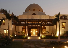 The entrance of the Ismaili Centre, Dubai is adorned by fountains, trees and a five-arched teak and meranti portico.