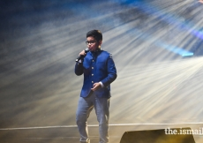 """A young artist sings at the afternoon International Talent Showcase themed """"Marvel."""""""