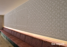 A carved plaster wall is the focal point of the multipurpose room at the Ismaili Jamatkhana and Centre, Khorog.