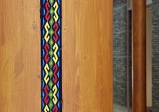 Inlaid fabric pattern on wood columns at the Ismaili Jamatkhana and Centre, Khorog.