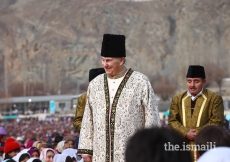 Mawlana Hazar Imam walks through the Jamat during the Darbar at Taus, Yasin