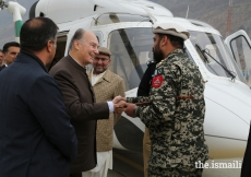 Mawlana Hazar Imam is greeted by Colonel Moinuddin, Commandant Chitral Scouts, upon his arrival at the Chitral Town Airport