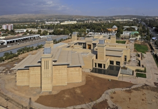 October 2009: A view of the Ismaili Centre, Dushanbe complex with the Prayer Hall in the foreground. Landscaping continues to progress.