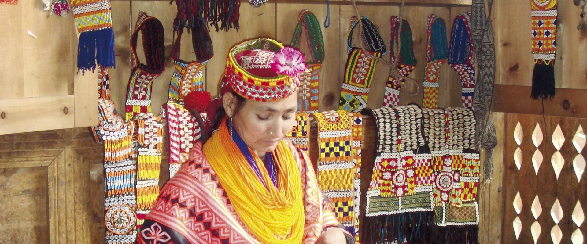 FMFB-P has provided micro loans in the mountainous valley of Chitral called Kalash where this women is making a traditional Kalashi dress in her small shop. Taking a micro loan allows women like this one to send her children to school.
