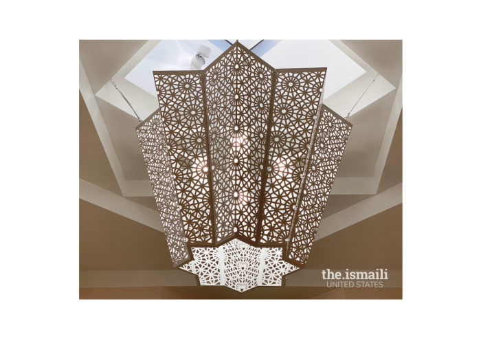 A view of one of the chandeliers in the social hall lobby. This image is an example of how the lighting inside the main building is designed to be indirect, to eliminate glare and reduce the harshness of exposed bulbs and fixtures.