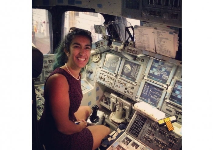 Farah sitting in the space shuttle simulator during a trip to NASA's Kennedy Space Center.