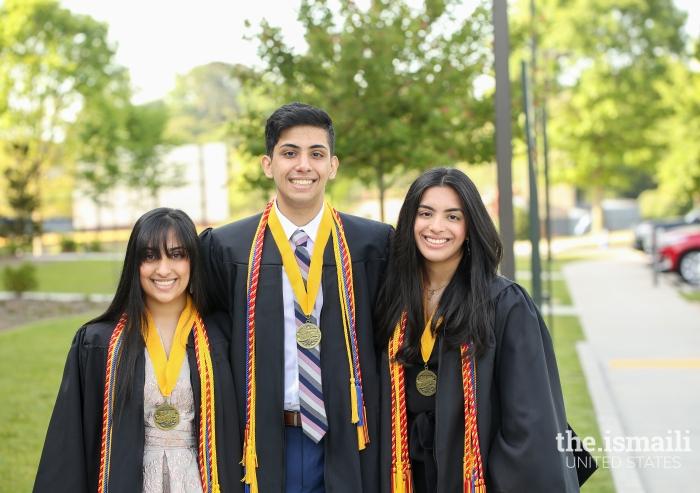 Alma, Aqil, and Anusha Merchant pose for a sibling photo at their high school graduation.