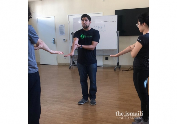 Shawn Lopez illustrating some of his mobility exercises for an Aga Khan Youth and Sports Board program.
