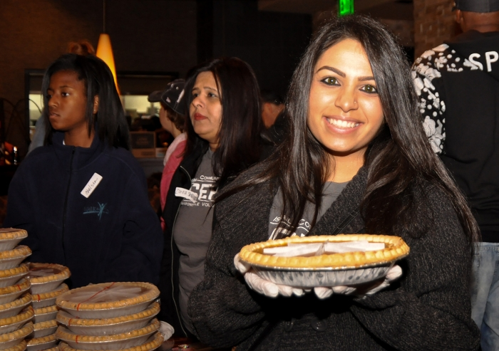 An Ismaili volunteer prepares Thanksgiving pumpkin pie as part of Operation Turkey to deliver meals for people in need in Dallas. Sara Maherali