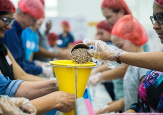 Members of the Ismaili Muslim community and other volunteers, in partnership with Feeding Children Everywhere, pack 100,000 healthy meals Sunday at Ismaili Jamatkhana and Center in Carrollton. The meals will be delivered to victims of Hurricane Harvey.