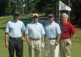 Participants pose at the Atlanta golf tournament, held at Country Club of the South.