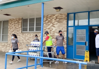 I-CERV volunteers partner with the City of Dallas and Borden Dairies to distribute milk and food to families in need.