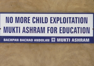 A sign posted at an Ashram run by an Indian NGO that helps child labourers decries child exploitation.