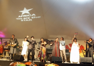 """Following their performance at the World Cup Kick Off concert, Salim and Sulaiman Merchant, Alisha Popat and their fellow musicians perform the song """"Africa You Are The Star"""" at the Carnivore Grounds launch in Nairobi."""