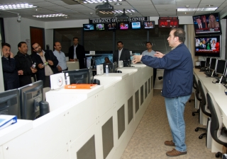 Michael Kahlenberg leads FOCUS Regional Disaster Managers on a tour of the Emergency Operations Center at the Harris County Office of Homeland Security and Emergency Management in Houston.