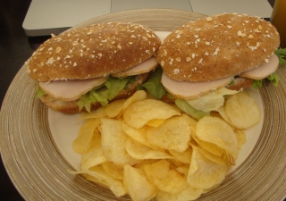Not all burgers are bad for you. Try this wholemeal roll with turkey (or chicken) slices.