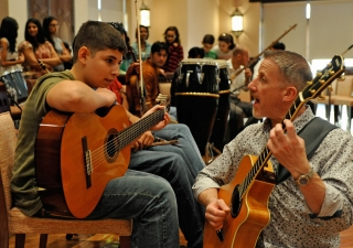 During rehearsal, Paul Griffiths works with a Syrian musician from the UAE Jamat.