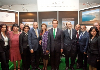 Jamati volunteers and representatives from AKF USA and FOCUS North America gather with Prince Hussain, Governor Schwarzenegger and his wife in front of the AKDN information booth at the Governors' Global Climate Summit 3, which was hosted at the Universit