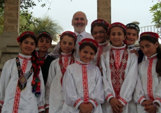 The Tajik students together with Les Wilkins, the Head of the Junior School, dressed in traditional Pamiri outfits for the Junior School Assembly celebrating Navroz.