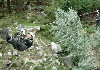 Fauzia of the FOCUS Search and Rescue Team, Gilgit demonstrates an evacuation technique.