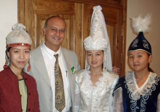 Nasir Jetha with traditional dancers in Kyrgyzstan, where he served as a TKN volunteer at the University of Central Asia.