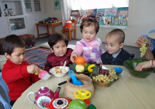 Children play with everyday food items as they learn about the world in which they live, at the National Council Sparks Early Childhood Development Program in Kabul.