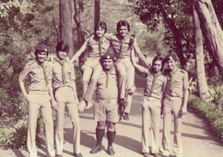 Karim Moledina (centre) enjoys a picnic with the Rovers of Darkhana Scout Group. In 2011, Moledina marked 50 years with the Scouts movement.