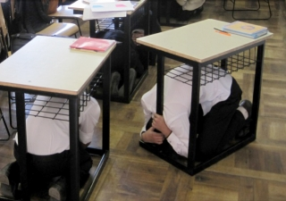 Students at a school in Kyrgyzstan take cover under their desks during the AKDN ShakeOut earthquake drill.