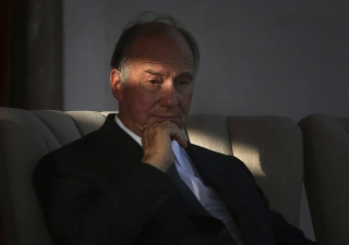 In this Sept. 18, 2013 file photo, the Aga Khan, spiritual head of Ismaili Muslims, listens to a speech during the inauguration of the restored 16th century Humayun's Tomb in New Delhi, India.