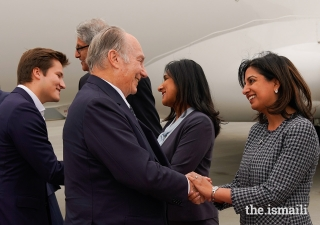 Mawlana Hazar Imam is greeted by President of the Ismaili Council for Edmonton, Zahra Somani, upon arriving in Edmonton for the inauguration of the Aga Khan Garden, accompanied by Prince Aly Muhammad.