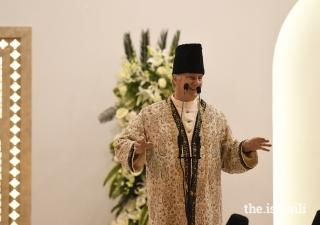Mawlana Hazar Imam shares a light moment with the Jamat at the Diamond Jubilee Darbar in Mumbai.