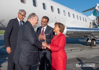 Upon his arrival in Vancouver, Mawlana Hazar Imam is greeted by Samir Manji, President of the Ismaili Council for British Columbia, and Zulie Sachedina, Chair of the International Conciliation and Arbitration Board.