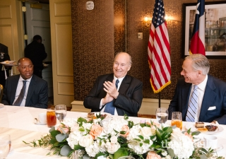 Mawlana Hazar Imam applauding following remarks by the Governor of Texas Greg Abbott, as Mayor of Houston Sylvester Turner looks on.