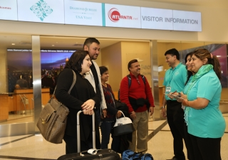 Volunteers welcome Jamati members arriving at Hartsfield-Jackson Atlanta International Airport from around the country for the Atlanta Mulaqat.